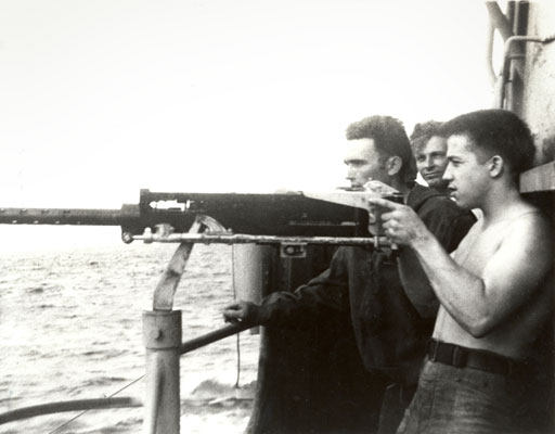 Bowfin crew members manning one of the 50 caliber guns.